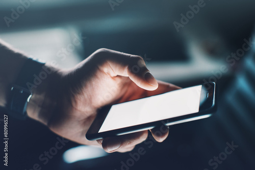 Closeup of man's hand with smartphone - 80996527