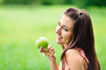 Young girl with green apple