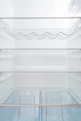 Empty shelves in fridge