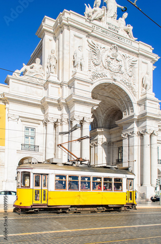 Traditional yellow trams on a street in Lisbon, Portugal - 80999548