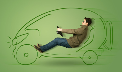Man drives an eco friendy electric hand drawn car