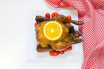 Roasted chicken and sliced orange,cherry tomatos with place for