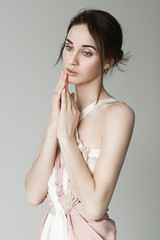 Portrait of a young beautiful girl in a light pink dress