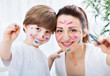 Adorable attractive mother and child painting success