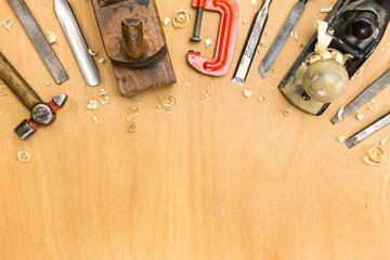 Set of tools on wood background