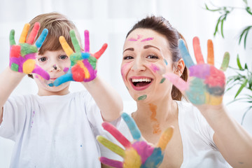 Happy smiling family with colorful hands