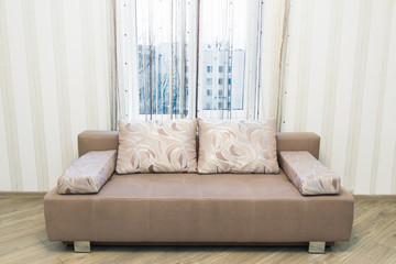Sofa in the interior, a large spacious room.