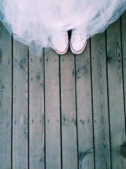 White sneakers on wooden background