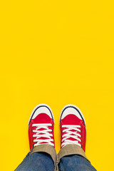 Feet From Above, Teenager in Sneakers Standing on Yellow Backgro