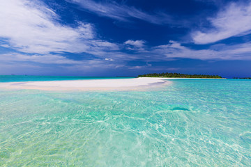 Sand bar at the end of tropical island with pristine water