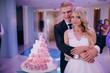bride cut a wedding cake