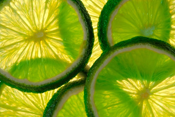 Green lime overlapped slices close-up background.