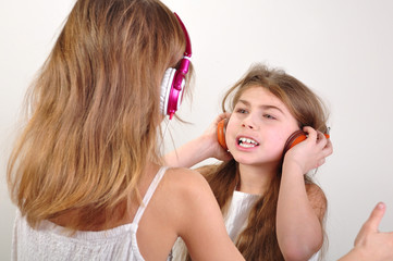 children with headphones listening to music