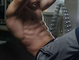 Young man doing abdominal exercises