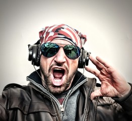 Man listening to music with a Usa Flash Bandana and headphones