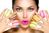 Beauty fashion model girl taking colorful macaroons - 81014370
