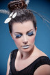 Luxurious silver makeup and hairstyle over blue background