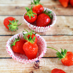 Sweet strawberries in the cake pans