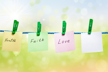 Messages written on a paper on green background