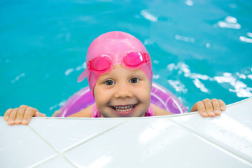 Portrait of little girl swimming  in swimming pool