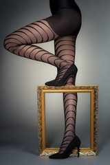 Stylish shot of woman's legs in fashion tights