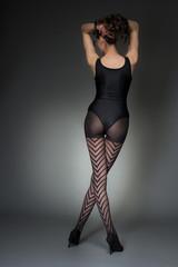 Stylish rear shot of woman in fashion tights