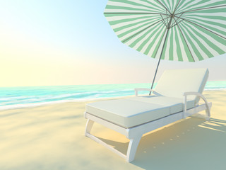 Couch and umbrella on a beach by the sea.