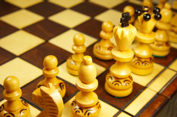 chess pieces on wooden board
