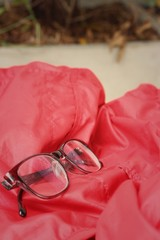 Black glasses on a background of red