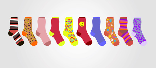 vector colorful socks on a gray background in the line