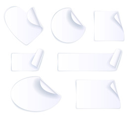 Set of white paper stickers isolated.