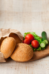 Hamburger ingredients on table