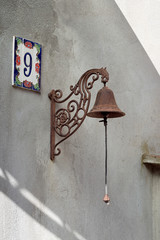 Doorbell, old style retro. With chain. House number 9 in sunshin