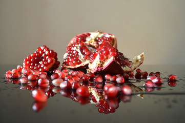 Pieces of pomegranate reflected in the glass surface