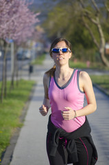 Young girl jogging outdoors