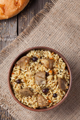 Pilaf is spicy indian food cooked with lot of rice, fried meat