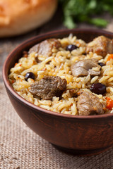 Tasty traditional pilaf meal with rice, fried meat, onion and