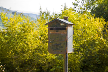 Old metal mailbox in the countryside. New ways of communication