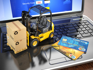 Concept of delivering, shipping or logistics. Forklift on laptop