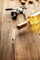 Glass bottle of wine with corks and corkscrew