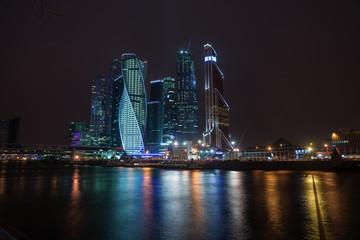 Picturesque night view of the Moscow City across the river Mosco