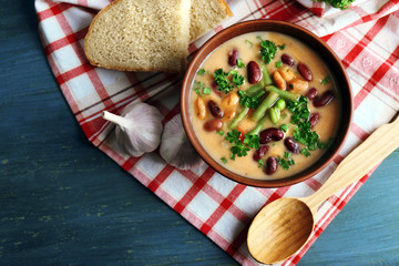 Bean soup in bowl with fresh sliced bread