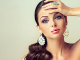 Fototapety Girl fashion model with graceful earrings and ring