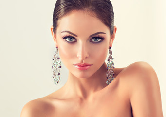 Girl fashion model with long graceful earrings