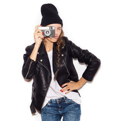 Pretty girl making photo using professional camera.