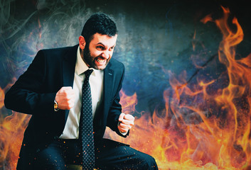 young businessman in anger burning fire