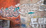 Fototapety Urban brick wall with grungy graffiti