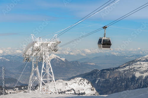 aerial ski lift arrival on french alps background - 81030795