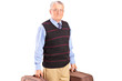 Smiling senior gentleman carrying two bags and looking at camera