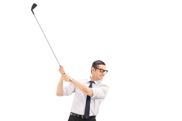 Happy businessman with tie trying to shoot a golf ball